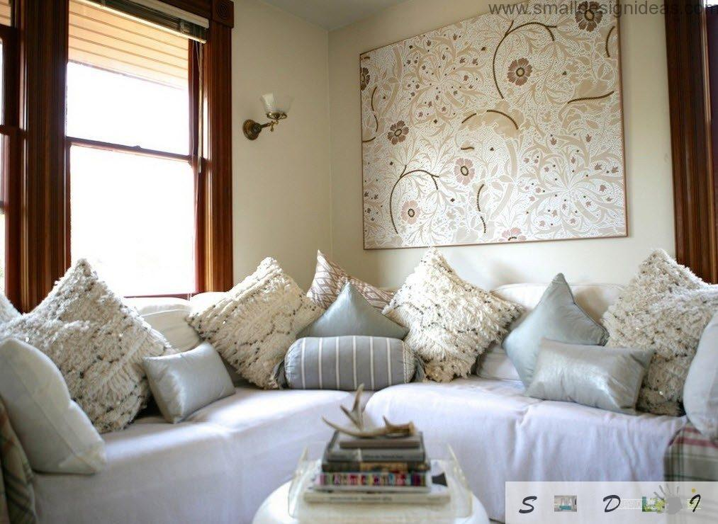 Pillows and classic sofa in the eclectic interior
