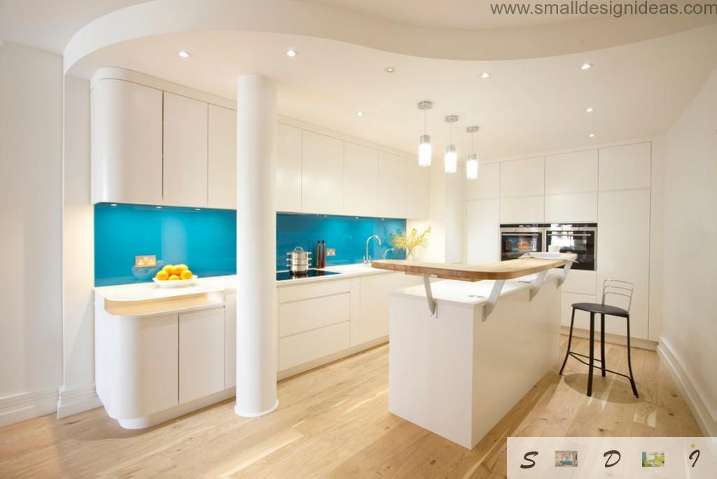Sleek shine surfaces in the white kitchen full of glass