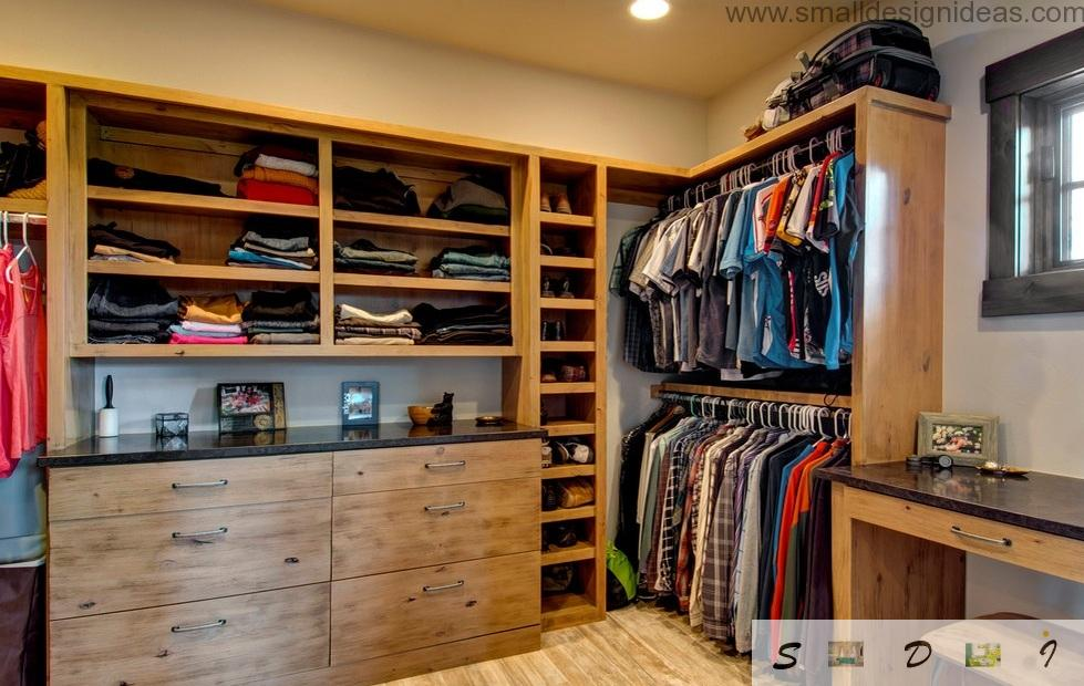 Fine wooden furnished closet with plenty of space and shelvings