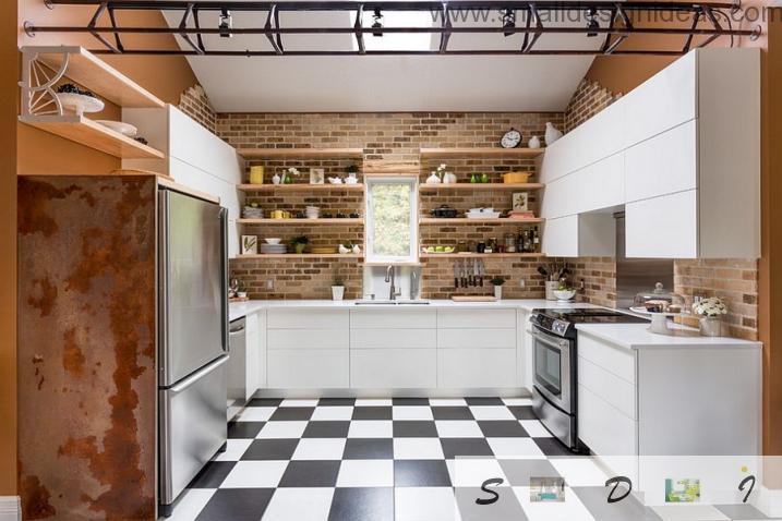 Chessboardlike floor in the kitchen with lots of shelves
