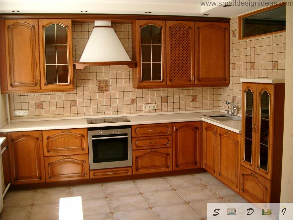Classic style in the kitchen requires carved natural wooden surfaces and conservative layout