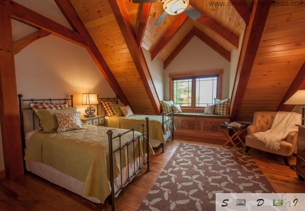 original design of the bedroom in the rustic style with veneered slopes