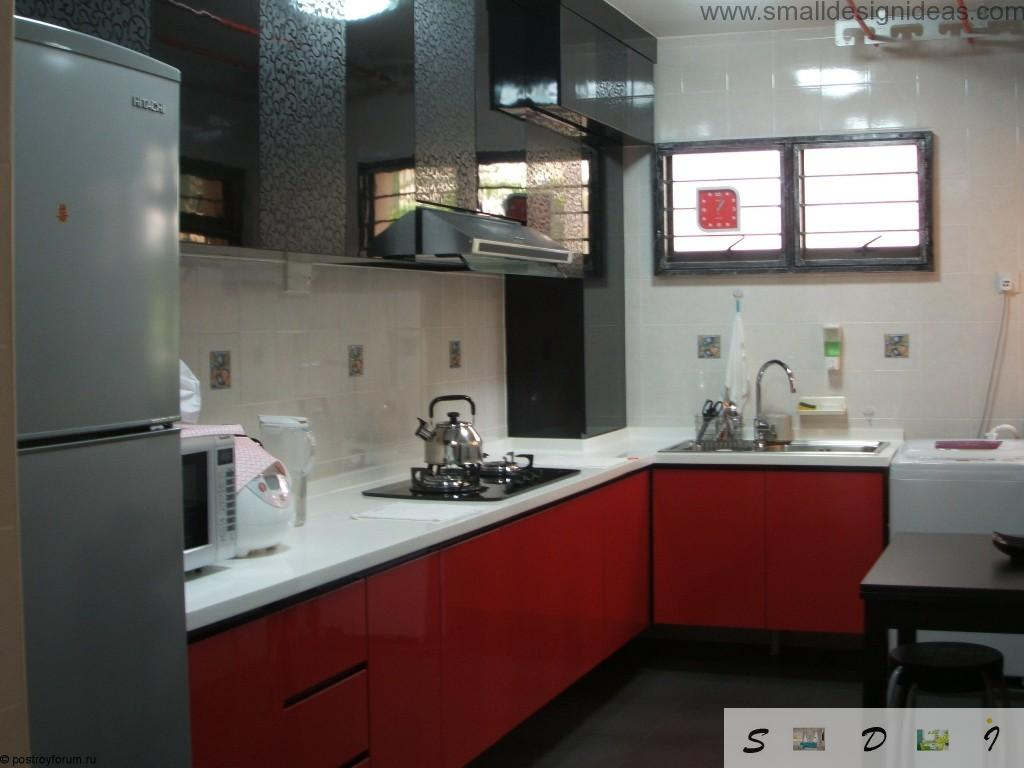 Hi-tech red glossy surfaces in the modern kitchen of middle size