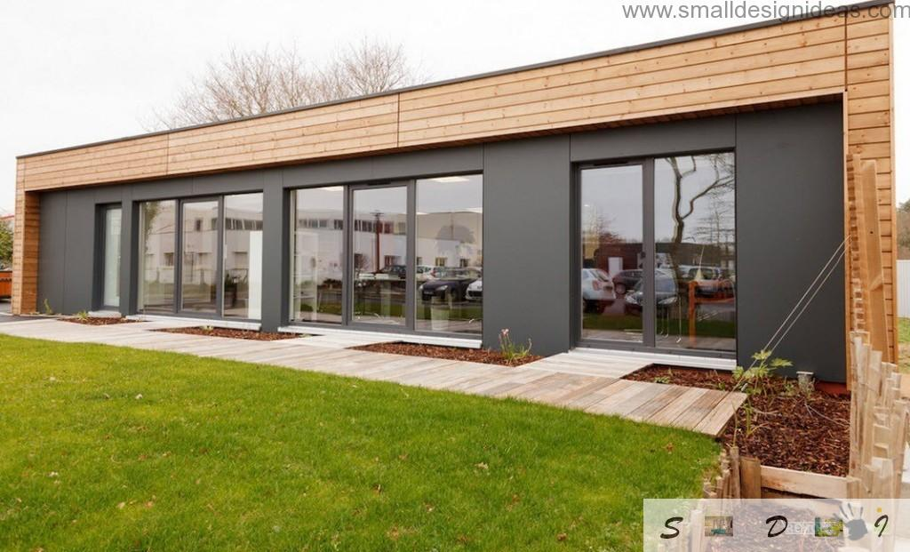 Grass and land slots for verdure within the adjoining area of the modern house view