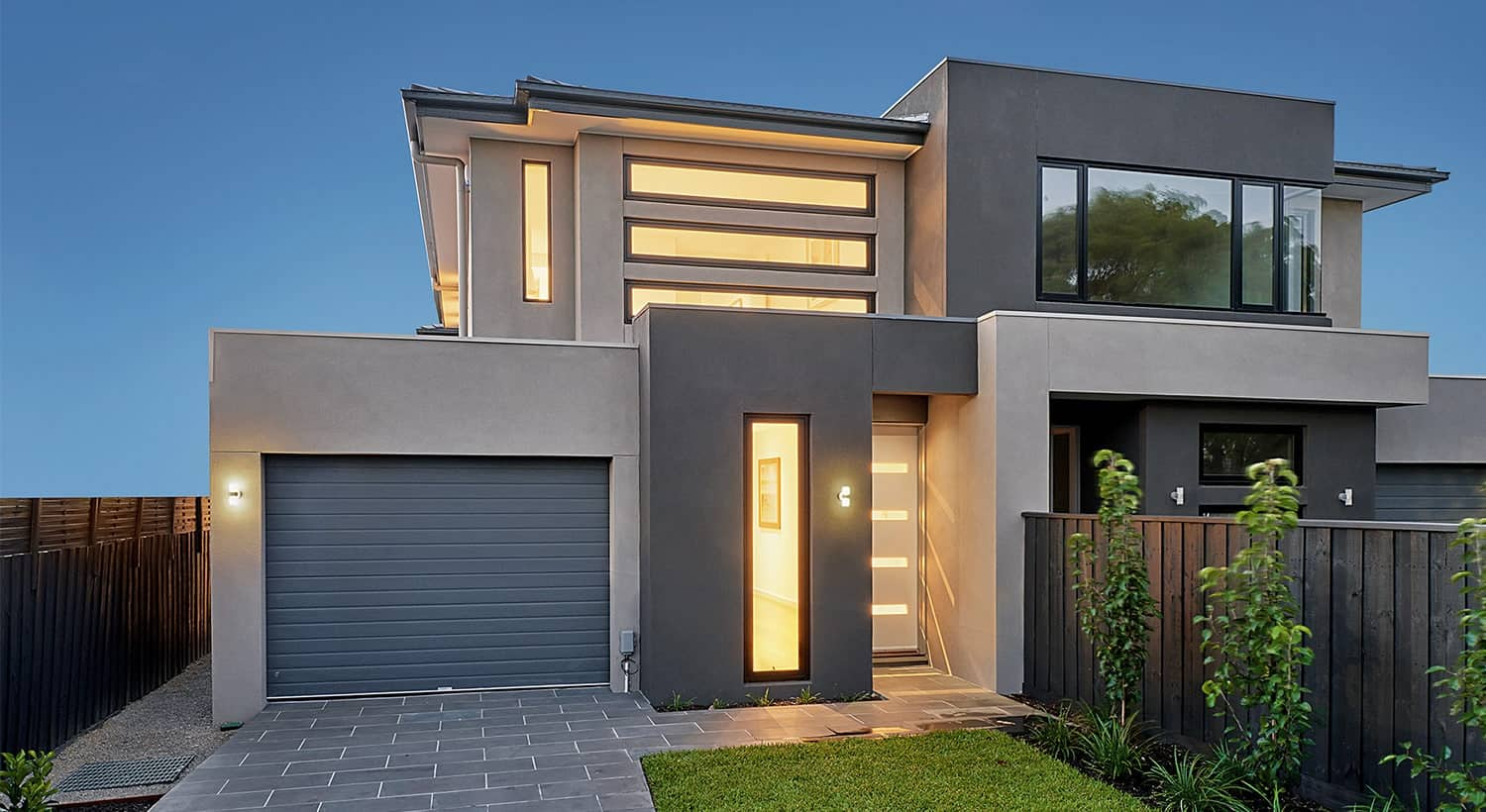 Modern House Exterior Design with Pictures. Mix of concrete surfaces of the house with narrow windows and doors