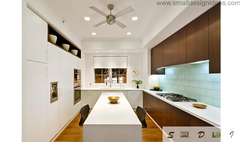 Ceiling fan makes the overall design of the white kitchen futuristic and a little bit extraterrestrial