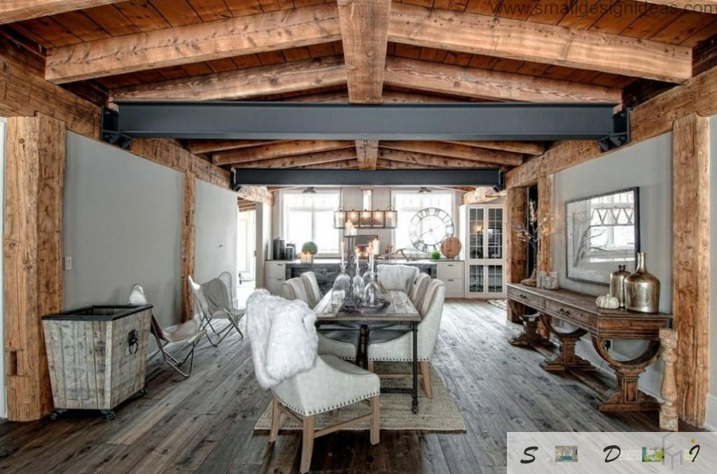 Wooden lining and steel beam are the focal point of this nice living