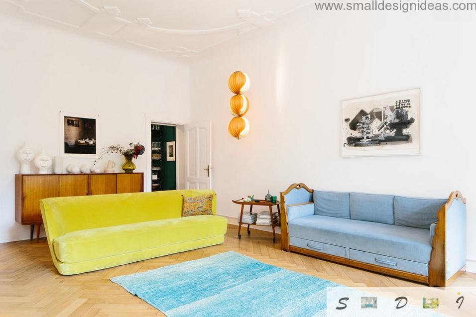 Middle Size Living Room Color Ideas. Yellow and blue furniture spots on the light living room interior