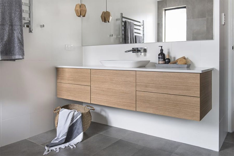 Wooden trimmed vainty for white Scandinavian bathroom