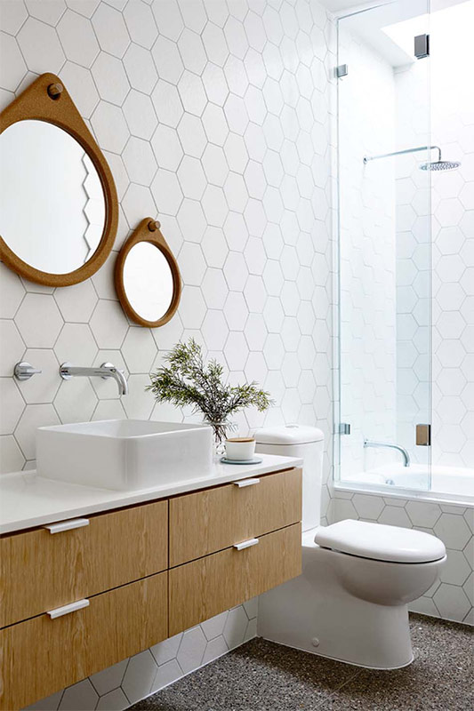 Hexagonal tile and white setting with slight addition of wooden decor for Scandi bathroom