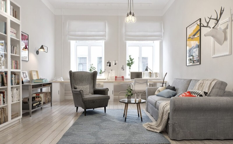 Pastel colored living room in Scandinavian style with gray rug and dark brown armchair