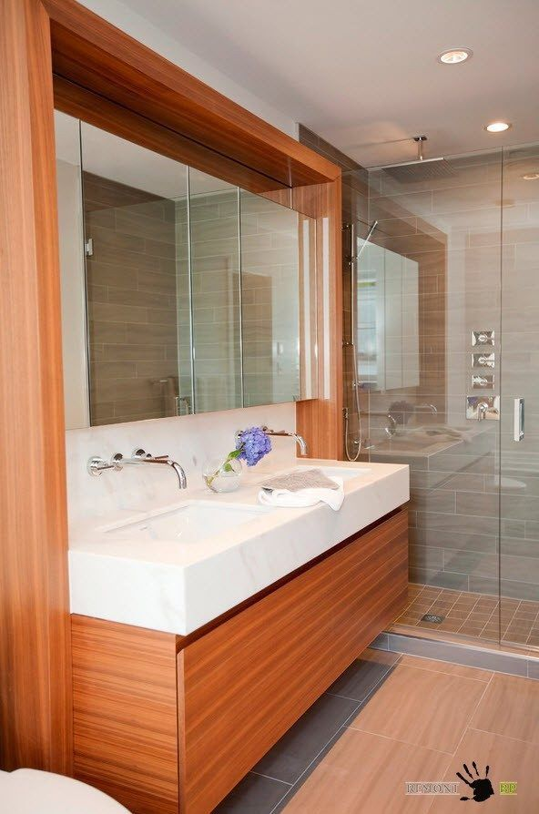 bathroom with double think and angle surface of the wooden counter