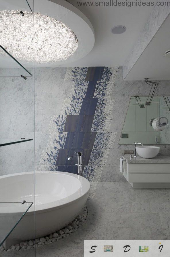 Round bathtub and decorative impressionistiс print on the white wall in the bathroom