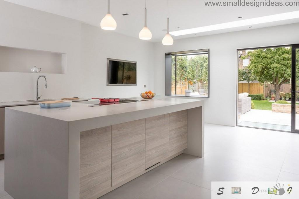Kitchen with concrete framed by wood island and parquet floor