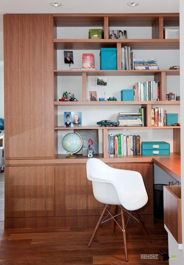 Study room with white walls, spotlight fixtures, wooden furniture and white contrasting chair