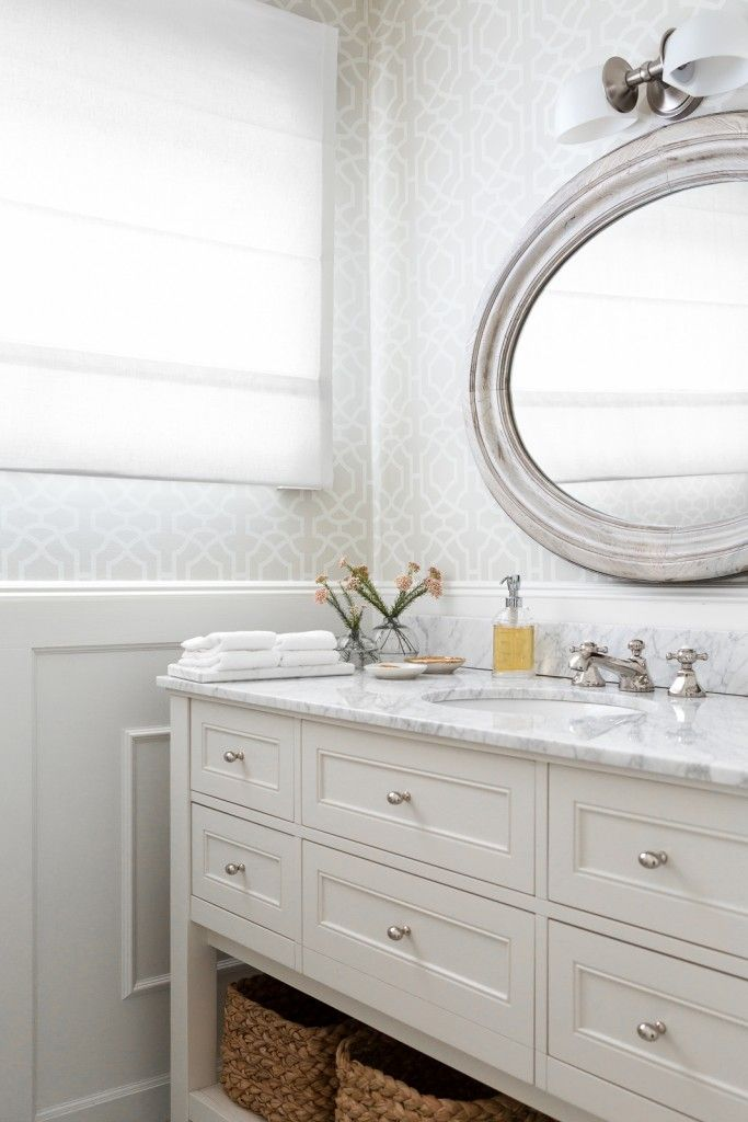 real marine touch in the bathroom is possible thanks to marble counter and sea elements in the furniture