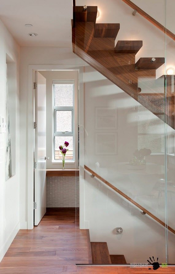 Wooden stairs and glass safety partition