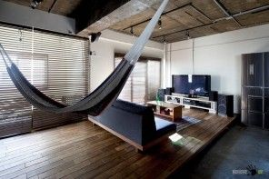 Hammock and sofa before the bed is a nice design idea for modern apartments
