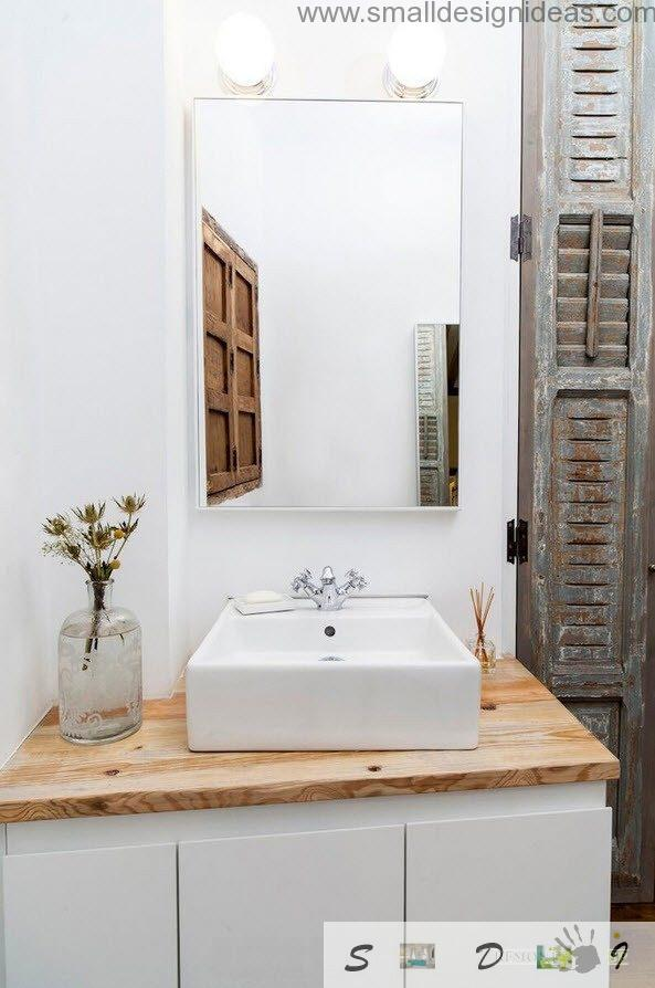 Wooden countertop and sink in the industrial apartment with weathered wooden surfaces