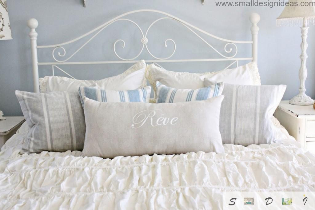 Neat tender tones of white and tulle lace on the linens is the main feature of the Provence in the bedroom