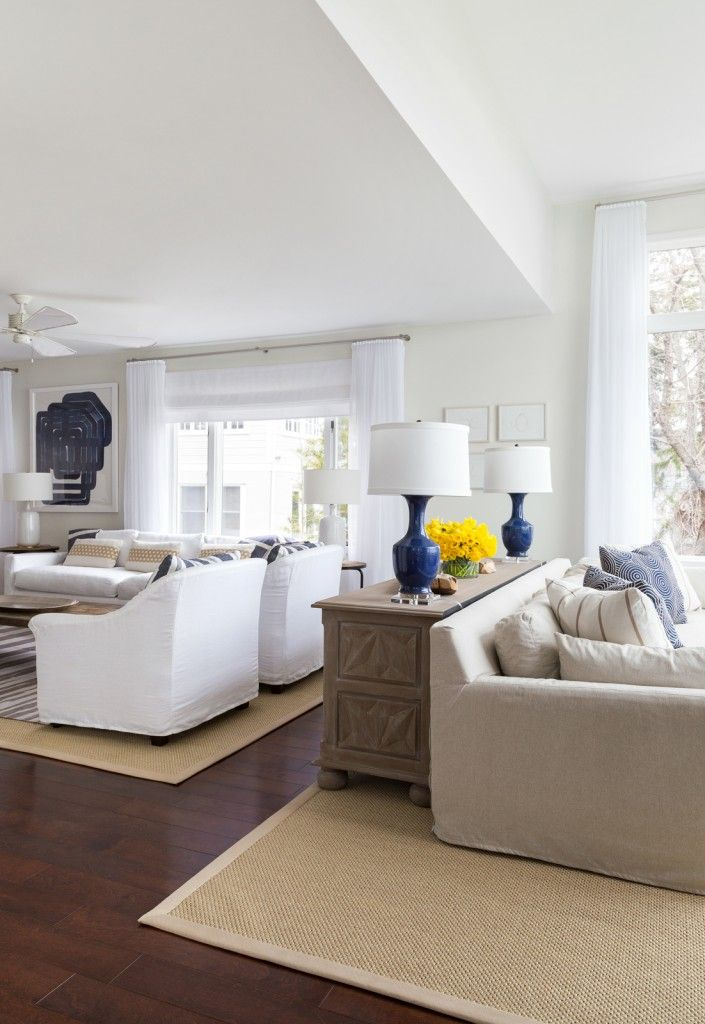 Marine Style House Interior Design. White and blue arranged livinf space with dark brown and sandy floor