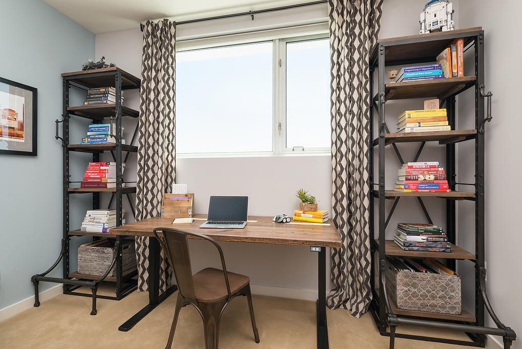 Small San Francisco Apartment Mixing Styles. Working table with laptop and monolithic wooden chair