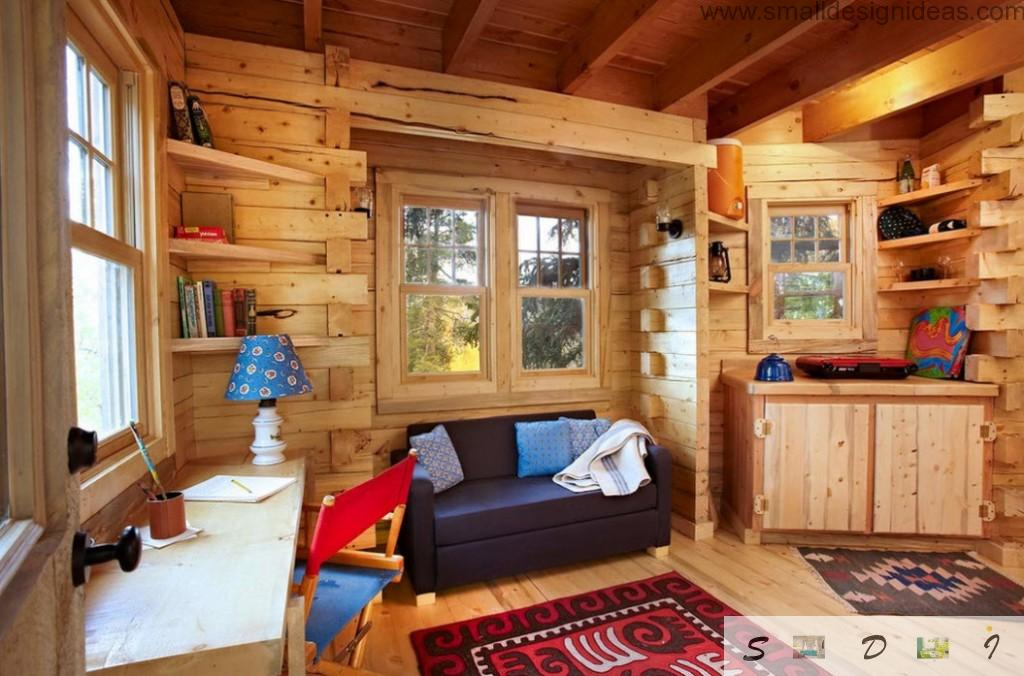 Nice interior arrangement of the spacious tree house with the opened beams