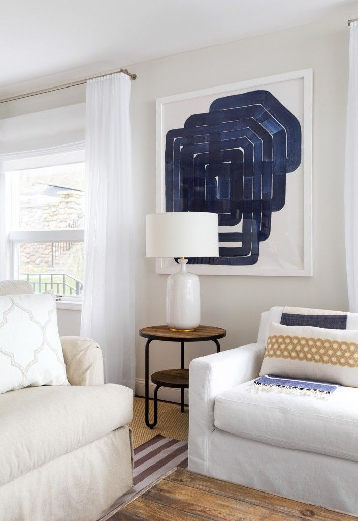 Marine Style House Interior Design. Expressionistic fugire on the wall instead of picture