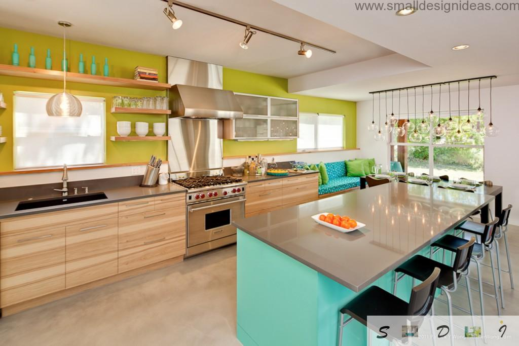 Pendant spotlight on the wooden board in the colorful kitchen looks maximum relevant