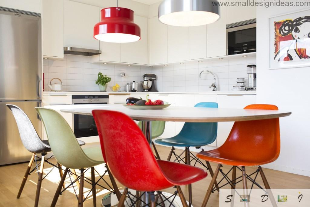 Modern interior of the kitchen and colorful chandeliers and furniture