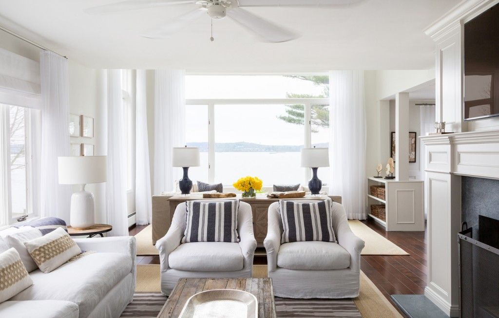 Marine Style House Interior Design. Striped sofas and white atmosphere in the living zone