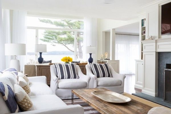 Marine Style House Interior Design. Overall view of the living zone with the wooden table and rustic looking metal dish on it