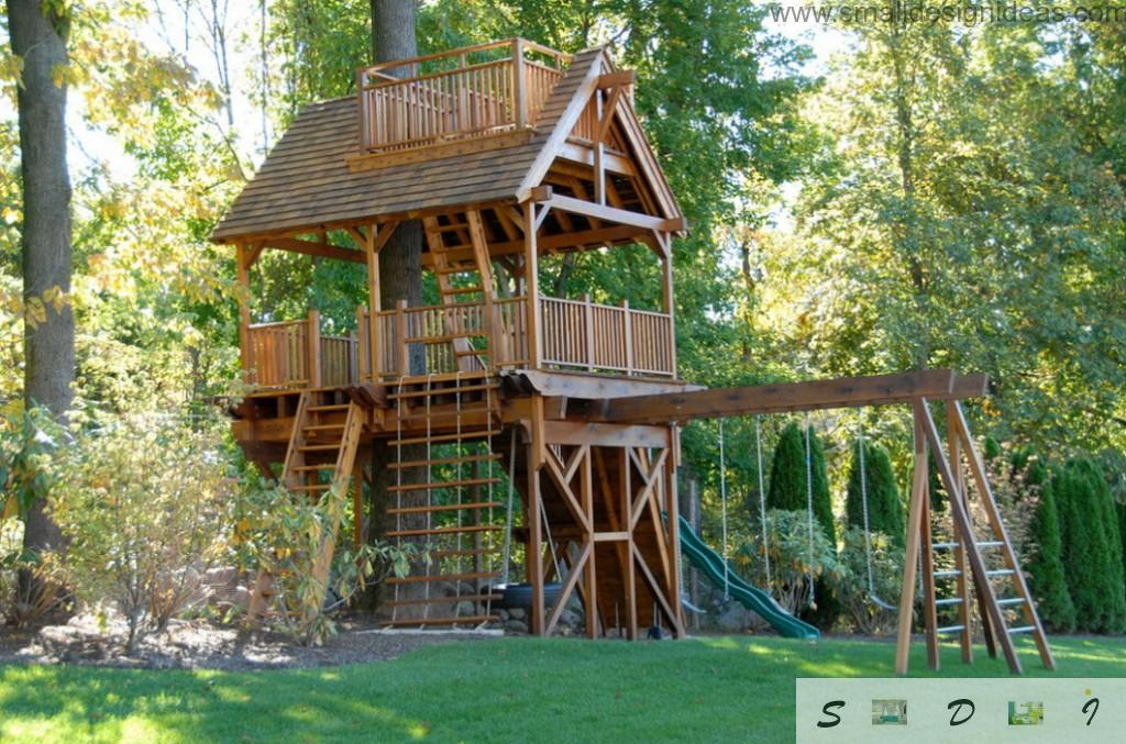 beautiful two-storey tree house with arbor at the top and ropes for kids playing