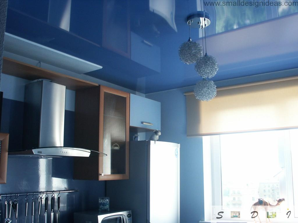 Blue glass chandeliers in the modern blue themed kitchen