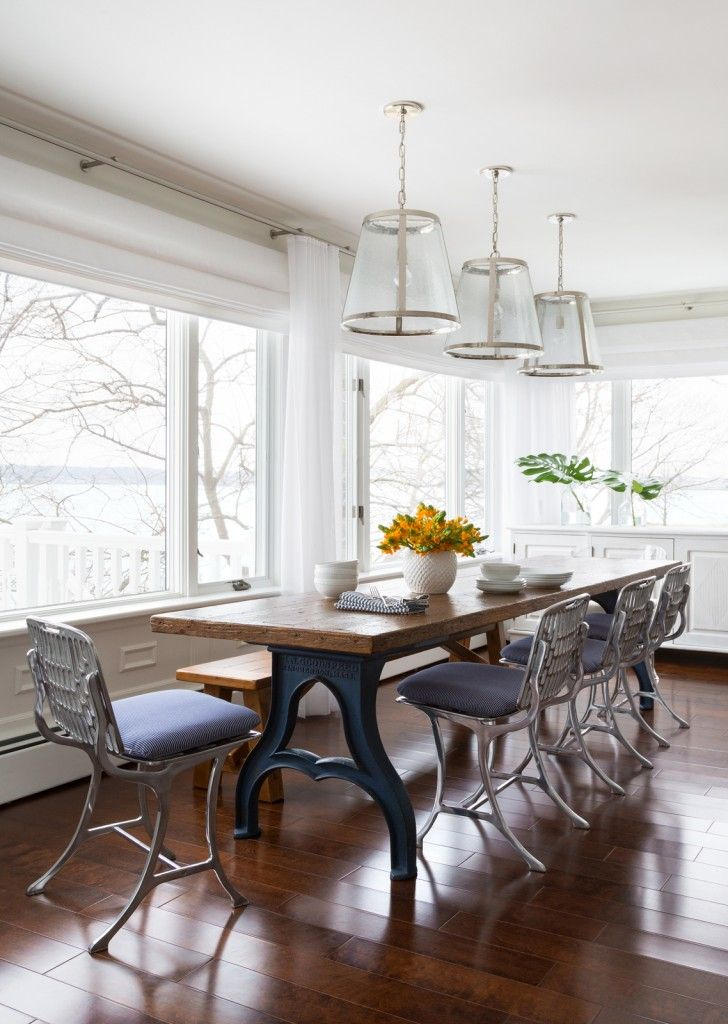 Marine Style House Interior Design. Kitchen with wooden table and steel uphostered chairs resembles rustic style