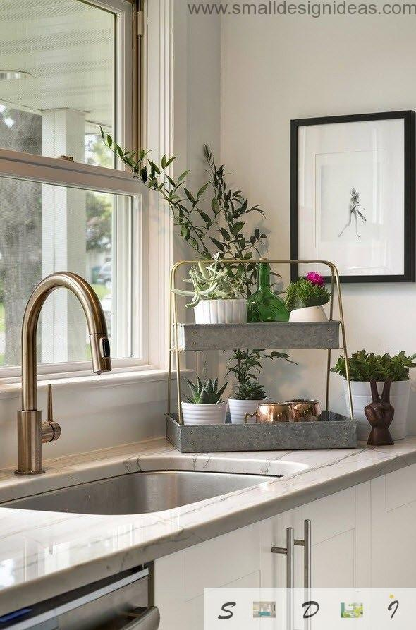 Eclectic kitchen with flowers and arched tap