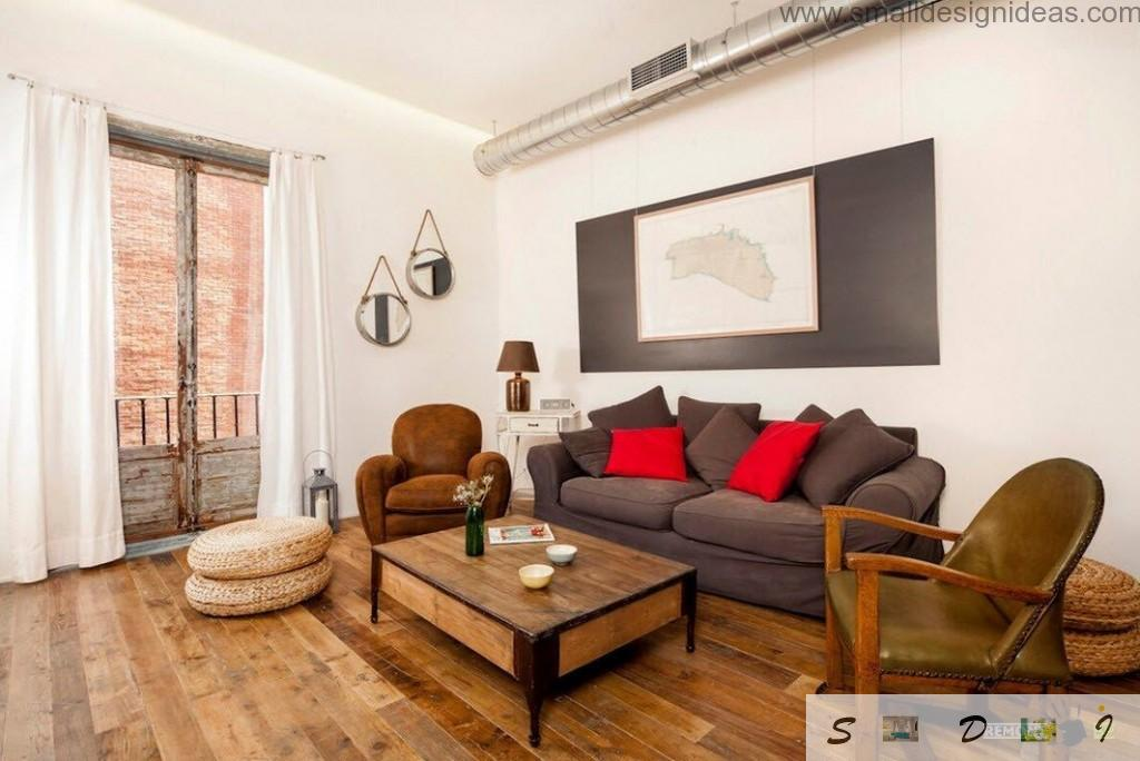 Industrial Interior Design Apartment with steel extractor tube and black panel with picture on the wall