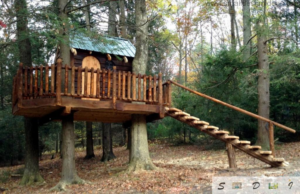 Nice tree house with green roof and wooden staircase
