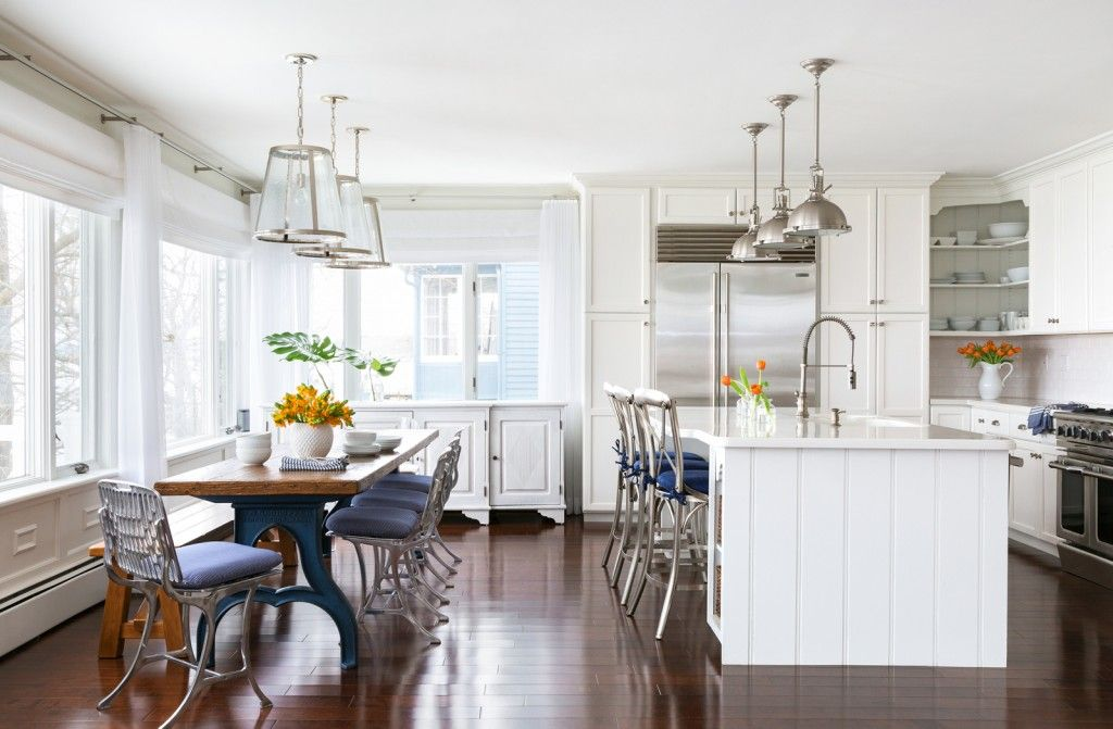 Marine Style House Interior Design. Full view through the spacious kitchen with an island in white tones