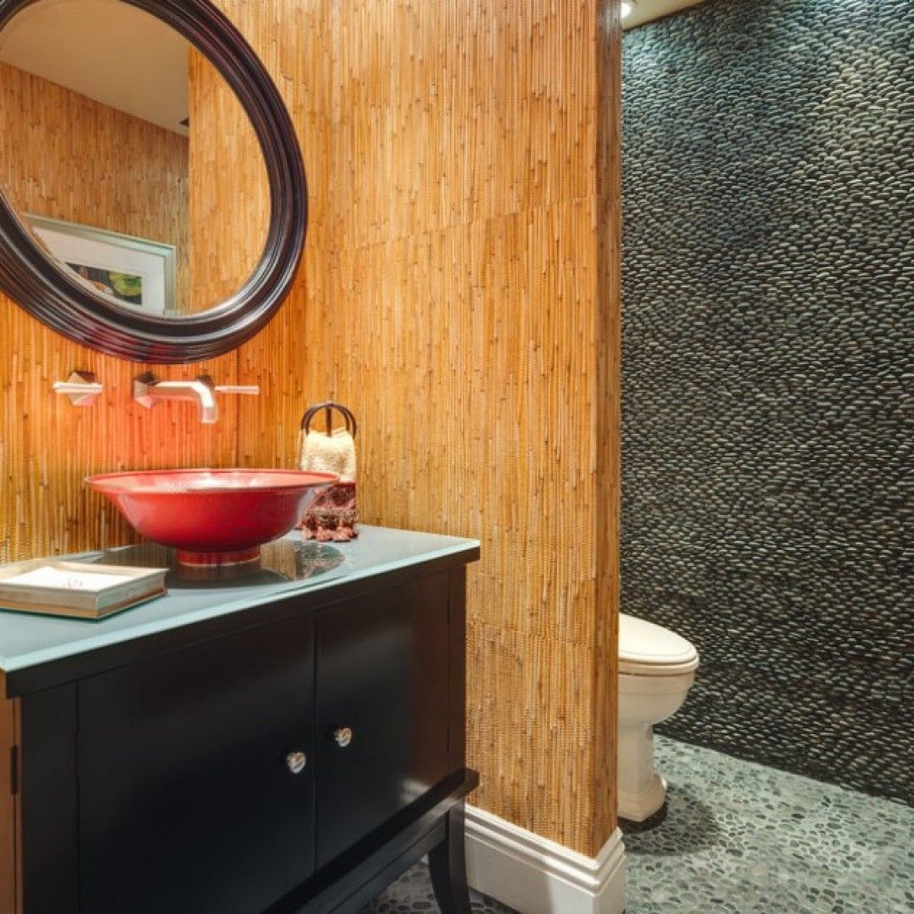 Bamboo interior in the Japanese bathroom contrasting with mosaic ile in the toilet