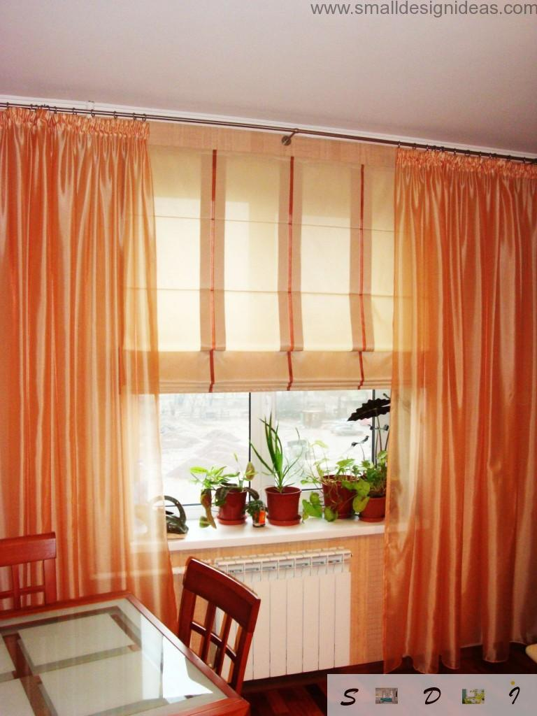 Joyful orange curtains in the interior of the modern kitchen