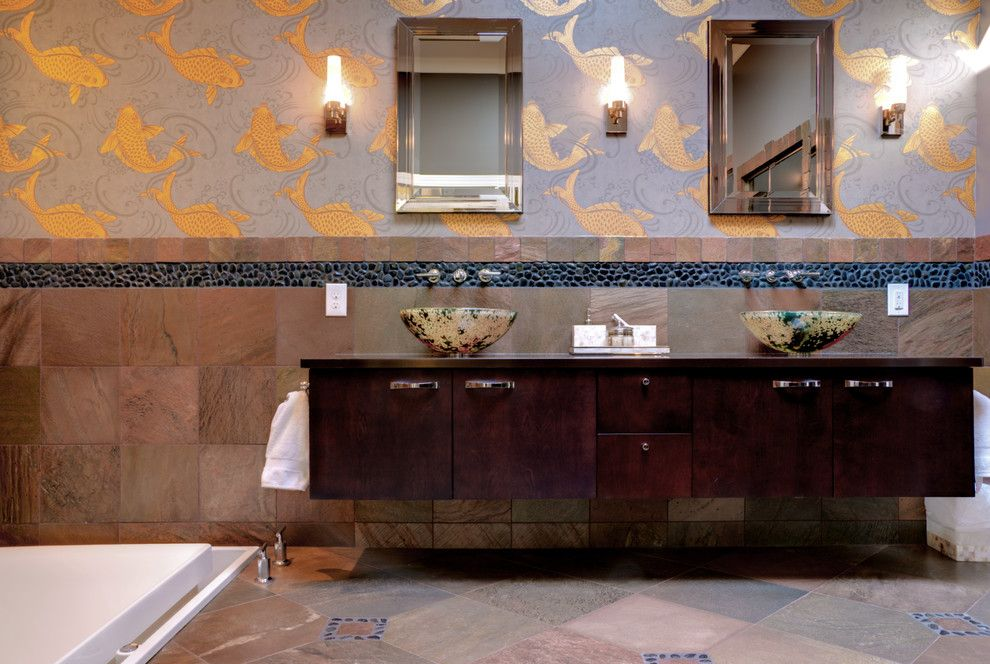 Elaborate wall decorated oriental style bathroom with wo visual wall zones