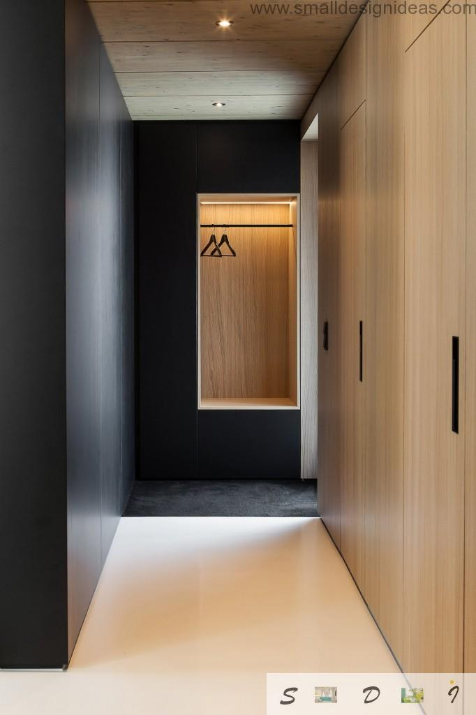 Hall in the wooden and black color palette in the German minimalistic house interior