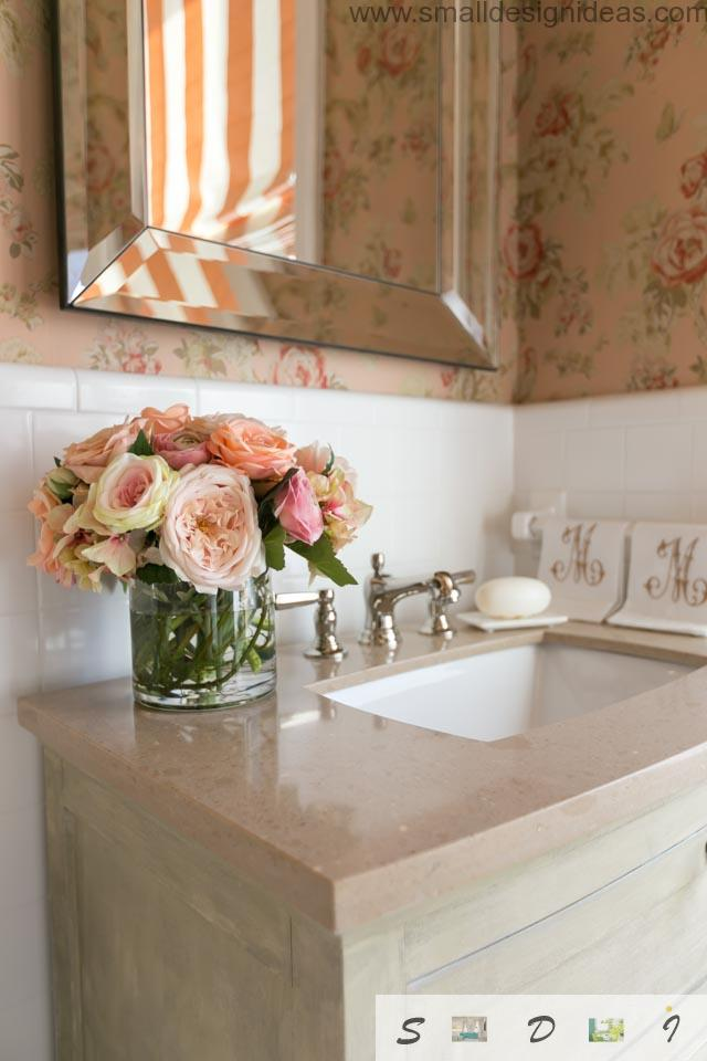 Marble countertop in the creamy warm classic atmosphere of the bathroom