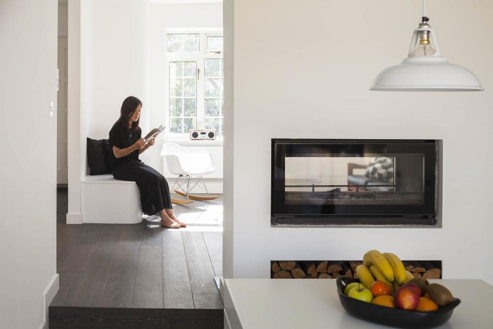 Girl reads in the Scandinavian interior