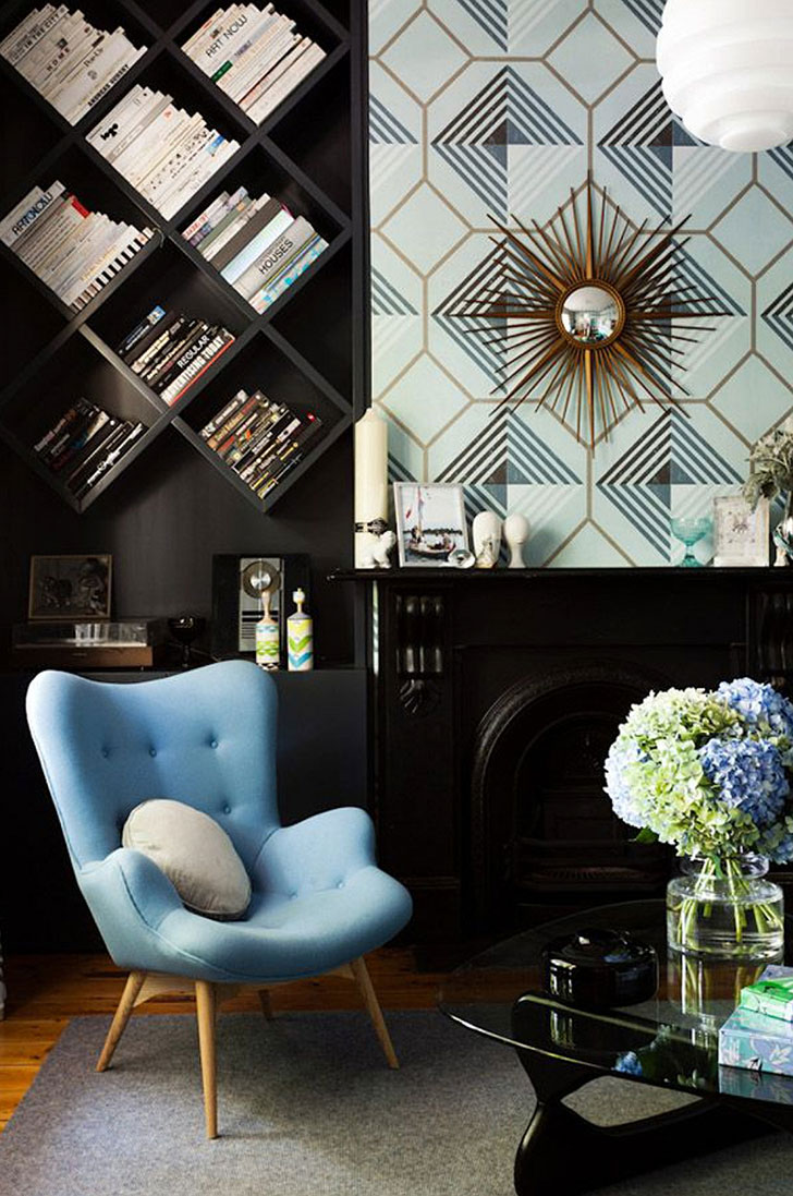 Typical Art Deco aptterns with streamline furniture, starburst decor, tilted bookshelf and dark wall paint