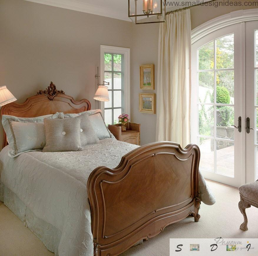 Wooden bed footboard in the royal looking Provence interior