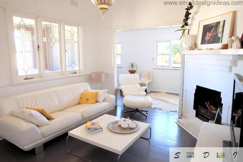Calm white living room with artificial fireplace