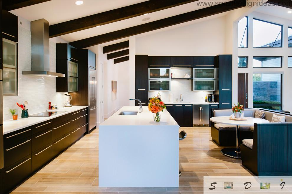 Sloped ceiling in the white interior of the island kitchen design project