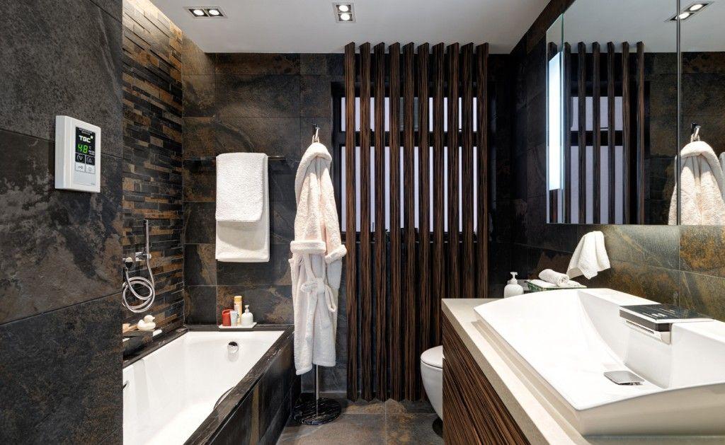 Indian dark bath design style with contrasting bathtub and sinks